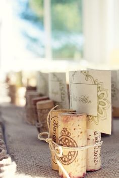 Wine cork name card holders for wedding place settings