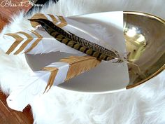 Feather Your Nest! • DIY ideas and tutorials for using feathers in your home decorating, like these DIY gold leaf feathers by 'Bliss at Home'!