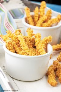 Cheese Straws..16-oz. pkg. shredded sharp Cheddar cheese, at room temperature 1-1/4 c. margarine, softened 3 c. all-purpose flour 1 t. cayenne pepper 1 t. salt Combine all ingredients together in a large bowl. Mix well, using your hands. Spoon dough into a cookie press with a star tip. Press dough in strips onto ungreased baking sheets; cut strips 3 inches long. Bake at 350 degrees for 12 to 15 minutes, or until orange on bottom and around edges. Cool on wire racks; store in an airtight…