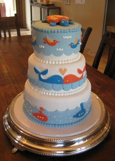 Ocean themed baby shower cake with turtles. whales. submarines and birds.
