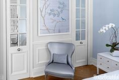 In the 9 1/2-by-15 foot bedroom, a custom de Gournay wallpaper panel hangs above a vintage chair in Fabricut's Chemical bond faux leather.
