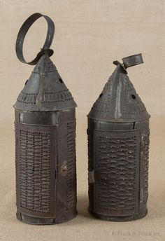 Punched tin lanterns like these were on the mantle in the big den.