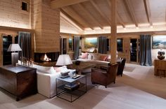 This cozy chalet is located in Gstaad, Switzerland, and was created by the London-based Ardesia Design. The interior mixes crude wood with more modern elements to create a sense of refuge from the outdoor woodland.                      Photos courtesy of Ardesia Design