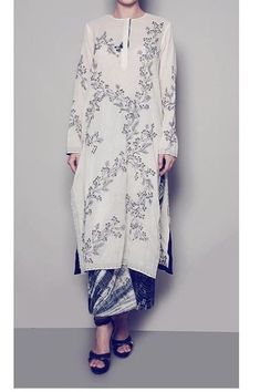 All over printed linen-satin kurti with printed pant and fine detailing.