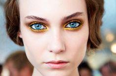 blue eyes & bright gold eye makeup