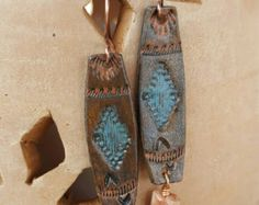 Thunderbird Earrings Tooled Leather Turquoise Pearl