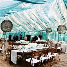 Clear tented wedding reception with draped transparent teal fabric | Lisa Franchot Photography, Los Angeles