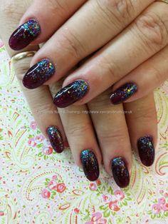 Plum raven gel polish with opal glitter