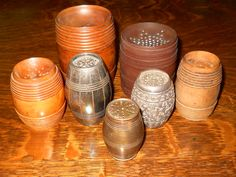 """Barrel Shaped Pounce Pots or Sanders. The dark brown barrel in the back looks like wood but on the bottom it reads """"Novelty Rubber Co. Goodyear Patent May 6, 1851."""" This was the year that Goodyear invented Vulcanized Rubber that would not melt in heat._Judith Walker's Collection"""