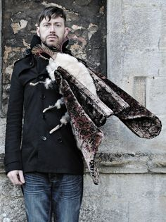 Mister Finch with one of his very large moths. Textile art.