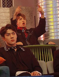 Sehun looks so done while Jonghyun is having the time of his lifeau