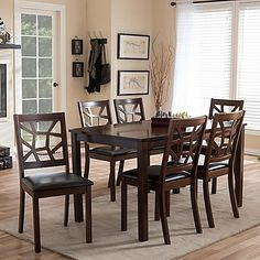 The Mozaika 7-Piece Dining Set from Baxton Studio boasts beautiful details, from the geometric motif on the upholstered chairs, to the glossy, matching table. This gorgeous set is perfect for serving family every day, or entertaining in style.