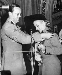 Dutch Prince Bernhard is seen in this April 6, 1951 image as he decorates Eva Peron with the Great Cross of the Orange Nassau in Buenos Aires. Prince Bernhard, the 93-year-old father of Queen Beatrix died today, at the UMC hospital in Utrecht, the Netherlands, Wednesday, Dec. 1, 2004. Bernhard suffered from a cancerous tumor in his lungs. Bernhards wife, the former Queen Juliana, died earlier this year. (AP Photo)