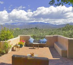 Santa Fe New Mexico architectural styles - Banco:  A plastered adobe bench built  into the base of a wall. Many  traditional-style homes have bancos,  either built near the kiva fireplace,  in a sitting room or outside on  a verandah or a portal.
