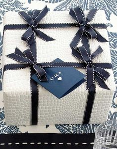 gift wrap / wrapping: chic navy & white style with multiple bows by Carolyne Roehm