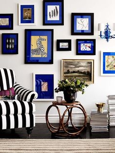 To unify a mismatched set of thrift store frames, take a tip from Design Sponge and cover the original mats in vibrant blue fabric.