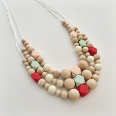 A personal favorite from my Etsy shop https://www.etsy.com/listing/233476172/silicone-teething-necklace-with-pendants