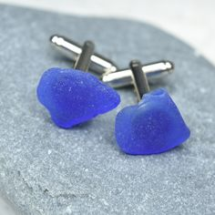 Handmade custom genuine surf-tumbled cobalt blue sea glass cufflinks. The silver cufflinks are made with naturally found genuine surf tumbled blue sea glass, that has a wonderful vibrant coloring and frosted surface. The sea glass is authentic frosted beach glass collected on the rocky shores and sandy beaches of Casco Bay, in Coastal Maine and the coast of New England. The sea glass has a lovely natural frosted surface as a result of the glass being tossed about the waves and ocean shores…