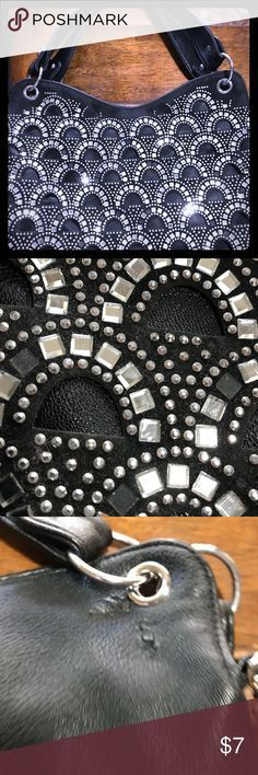 "Embellished Black Leather Tote I have loved this bag since I saw it for the first time. It has been my companion in many adventures wearing it with silver sandals and jeans. I always get lots of compliments. Some of its embellishments have fallen as you can see in the photos but people usually focus on its beauty. The back shows some of the wear that it has been through but who sees the back of a purse, right? Measurements: 11""x15"" Bags Totes"