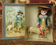 "The Memory of All That - Marquis Antique Doll Auction: 226 Sonneberg Bisque Doll as ""Mary Had a Little Lamb"" in Presentation Box Tiny Dolls, Old Dolls, Minis, Bisque Doll, Little Doll, Wooden Dolls, Antique Toys, Miniature Dolls, Doll Accessories"