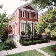 Simple white trim adds elegants style to this red brick home. See the inside: http://www.bhg.com/decorating/decorating-style/modern/warm-modern-style/?socsrc=bhgpin072412redbrickwhitetrim