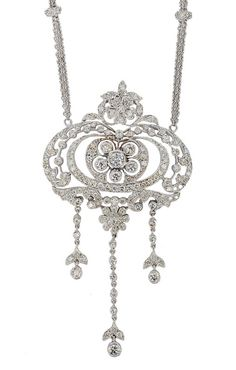 A floral diamond pendant with necklace    18 ct. white gold. Openworked pendant in the Victorian style with over 160 round cut diam. in total c. 2,60 ct. H-I.vsi-P. Pendant 68 x 36 mm, 2 row necklace with 2 small diamond-bars l. 40 cm, weight c. 15 g.