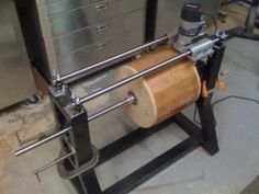 Wood Lathe - Homemade router-powered wood lathe intended to facilitate the process of turning drum shells. Constructed from rectangular tubing, ground rod, and hardware.