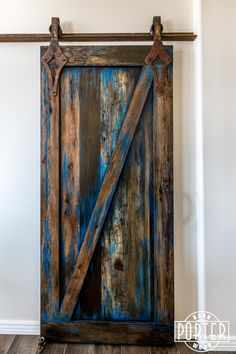 "A beautiful sliding ""Z"" style barn door with our ""ignite finish"" and antique style custom hardware."