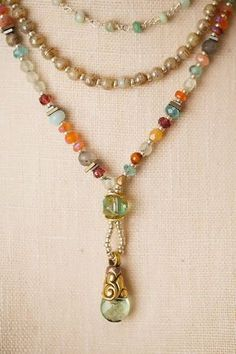 Subtle and vibrant colors come together in a refreshing palette! Semi-previous gemstones include carnelian, amazonite, smokey quartz, handmade Czech glass and much much more. A triple strand gives a