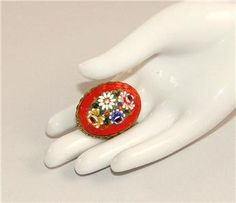 Vintage Adventure eBay listing for ANTIQUE RED MICRO MOSAIC PIN Brooch ITALY RAISED CENTER FLOWER Floral GLASS TILE ends Aug. 16, 2016.
