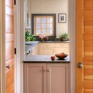 Doorway converted into a pass-through window. Kitchen by Crown Point Cabinetry (crown-point.com). Used by permission.