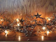 """Our Lighted Gold Pip Berry and Star Garland - 40"""" will brighten up a dark corner of your home and also add to your primitive look. http://www.primitivestarquiltshop.com/Lighted-Gold-Pip-Berry-and-Star-Garland--40_p_6409.html"""