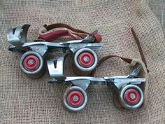 Globe roller skates No. 30. Metal skates with red wheels and red straps. The skates are fully functionaly. The strap on one of the skates has dry