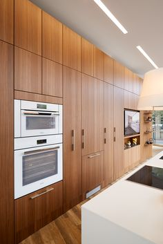 "SieMatic Pure Kitchen, SieMatic wood veneer, natural walnut (cabinets/panels), SieMatic ""Floating Spaces"" (wall/shelf system), Miele Speed Oven and Convection Oven, Brilliant White, M-Touch controls, Miele 30"" Fully-Integrated Refrigerator/Freezer"