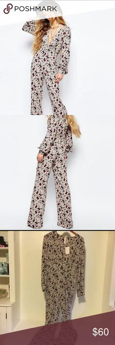 Free People Floral Jumpsuit 2 Never worn! FP size 2. Beautiful but I just haven't worn it and need to down size my closet :/ send me an offer :) Free People Dresses Long Sleeve
