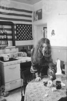 At home in her kitchen, reaches for book matches to light that cig... love her