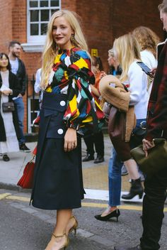 Kate Foley spotted on the street at London Fashion Week. Photographed by Phil Oh.
