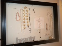 Use a push pin board to organize jewelry & quotable cards.