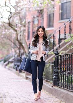 With striped jacket, light pink blouse and flats