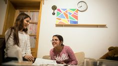 Nujeen helps her 26-year-old sister, Nisreen, with her German homework.