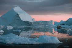 Fine art photographer Michael Schauer captures Icebergs on the coast of Greenland gently being lit by an arctic sunset creating a colour similar to Panone's living coral colour of the year 2019 Drone Photography, Landscape Photography, Glaciers Melting, Arctic Landscape, Natural Scenery, Humpback Whale, Once In A Lifetime, Color Of The Year, Taking Pictures
