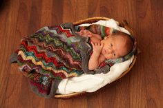 Found this oh so cute baby blanket pattern on  http://www.ravelry.com/patterns/library/zig-and-zag-sock-yarn-pram-baby-blanket