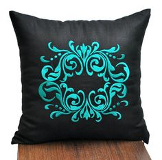 Medallion pillow cover which made from black linen and embroidered with Turquoise Medallion at the center.  This pillow cover has hidden zipper and it is available in size 16 x 16, size 18 x 18, size 20 x 20, size 24 x 24 and size 26 x 26. Choose the size you need by using the Size drop down menus. This listing is for pillow cover only without insert/filler.  Mora black pillow covers are available here https://www.etsy.com/shop/KainKain?section_id=6743456&ref=shopsection_leftnav_1  This…