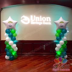 Anniversary logo on spiral balloon columns...great way to personalize your balloon decor! #partywithballoons