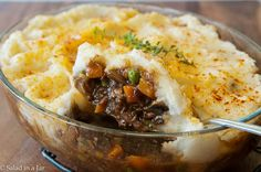 WEEKNIGHT SHEPHERD'S PIE using leftover mashed potatoes:      Beef Layer  1/4 cup chopped, fresh, or frozen onion  4 ounces chopped, fresh, or canned mushrooms  1 cup frozen peas and carrots  1 package (.87 ounce) brown gravy mix mixed with 1 cup water  2-3 cups leftover beef roast, fork-shredded or one package 17 ounce beef roast au jus (My grocery store sells Hormel, which is good.)  1/4 teaspoon dried thyme  Freshly-ground pepper  Paprika  Spray butter.