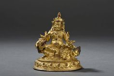 Statuette de Jambhala en bronze doré Tibet, XVIIe siècle Représenté assis sur un lion, la tête tournée vers le haut, gueule ouverte, couché sur une base lotiforme, la divinité vêtue d'une armure ciselée… - Daguerre - 15/06/2015