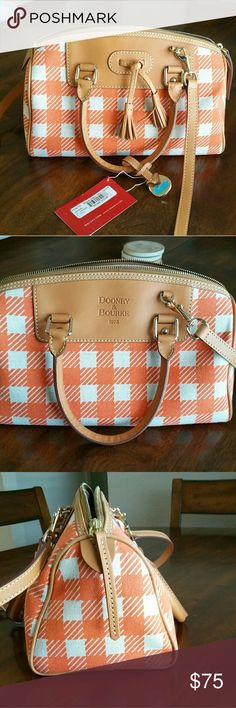 """NWT Dooney & Bourke Handbag Beautiful """"tangerine"""" and cream woven canvas satchel with camel leather. It really is a must-see; the bag looks even better in person. It measures 11""""L X 6""""W X 6""""D. It has leather handles and removable, adjustable leather shoulder/crossbody strap. The inside has a slip pocket for small cell phone, a larger zipper pocket, and attached key clip. Dooney & Bourke Bags Satchels"""
