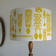Contemporary screen printed Welsh lovespoon lampshade. Organic cotton lampshade printed with traditional welsh love spoons, designed exclusively for us by Gwyn Williams. Each lampshade is hand screen-printed in our studio in north Wales using eco-frien...