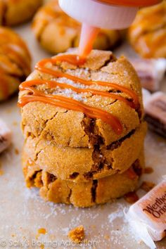 Soft-baked molasses crinkle cookies with a generous drizzle of caramel on top | sallysbakingaddiction.com