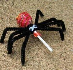 This adorable treat is fun to make and super easy. All you need is: a tootsie pop, black pipe cleaners, googley eyes, and glue. Instant and creative party favor or Halloween treat!